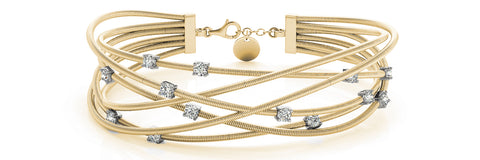 yellow gold flexible criss cross diamond bangle