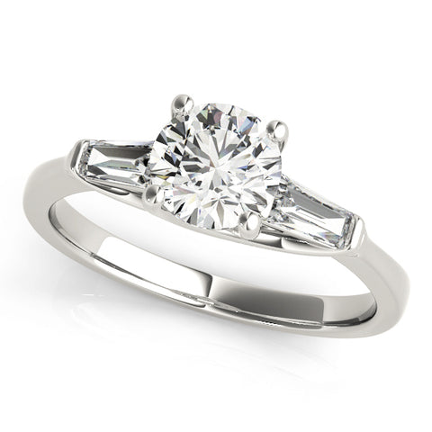 white gold three stone diamond engagement ring with baguettes and a round center diamond