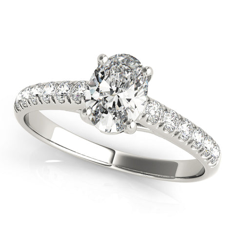 platinum single row diamond engagement ring with an oval diamond
