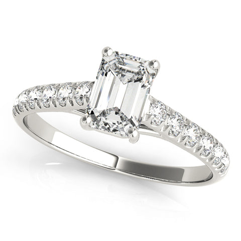 platinum single row diamond engagement ring with an emerald cut diamond