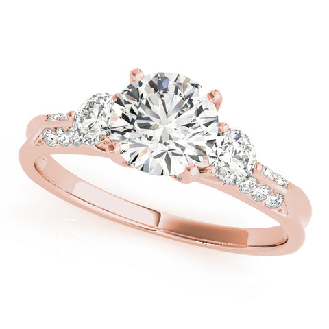 rose gold three stone diamond accented engagement ring