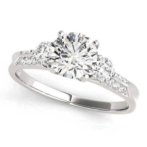white gold three stone diamond engagement ring with accent diamonds on shank