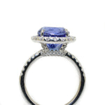 14kt white gold tanzanite and diamond halo ring