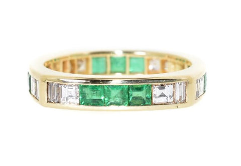 yellow gold diamond and emerald eternity ring