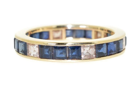 yellow gold blue sapphire and diamond eternity ring
