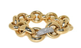 yellow gold handmade link bracelet with diamonds that accent one white gold link