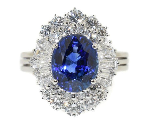 white gold ring with an oval Ceylon blue sapphire with a diamond halo