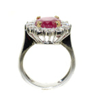 white gold ring with Burmese ruby that is prong set in yellow gold with diamonds