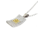 white gold diamond and yellow sapphire pendant