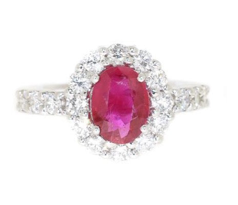 white gold ring with oval ruby and diamonds