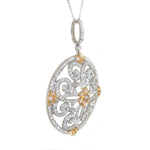 white gold and yellow gold diamond floral circle pendant