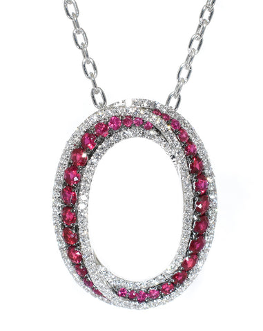 white gold ruby and diamond oval pendant
