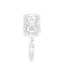 white gold emerald cut and round brilliant diamond rings