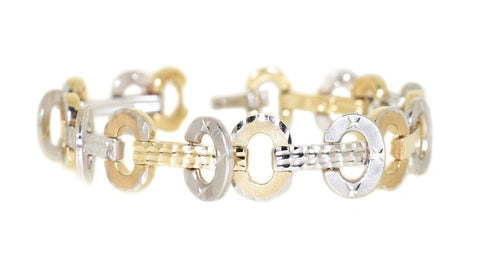 yellow gold and white gold movable oval link bracelet with diamond cuts