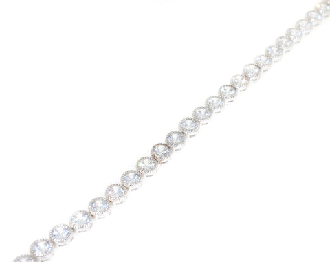 sterling silver cz tennis bracelet with milgrain