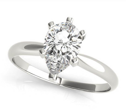 white gold solitaire engagement ring with a pear shaped diamond