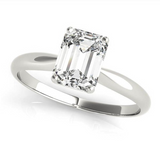 white gold solitaire engagement ring with an emerald cut diamond