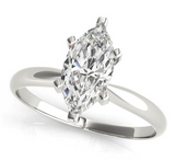 white gold solitaire engagement ring with a marquise diamond