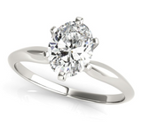 white gold solitaire engagement ring with an oval diamond