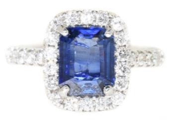 white gold blue sapphire and diamond halo  ring