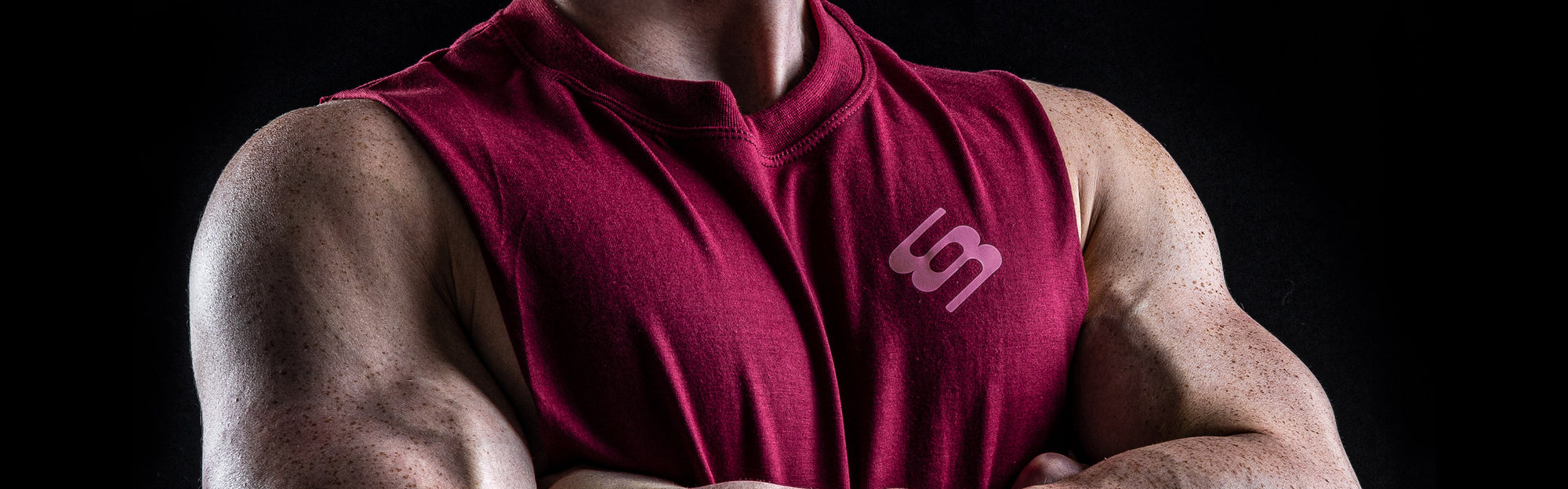 Our story - banner image of man wearing Bettyswollox cherry red tank