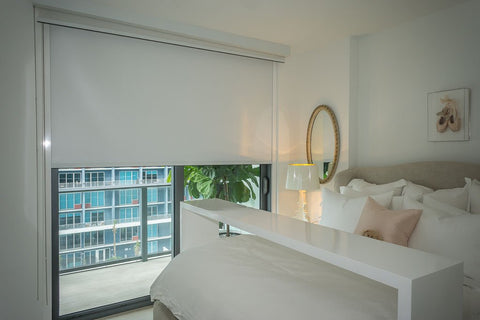 blackout blinds in a bedroom with balcony