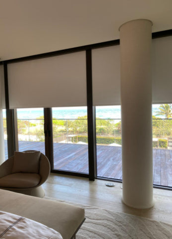 White blackout blinds with black side track