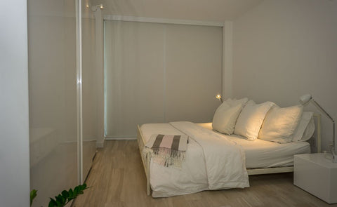 White blackout shades with side tracks in bedroom