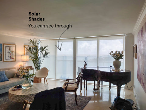 Living room with solar shades for sliding doors