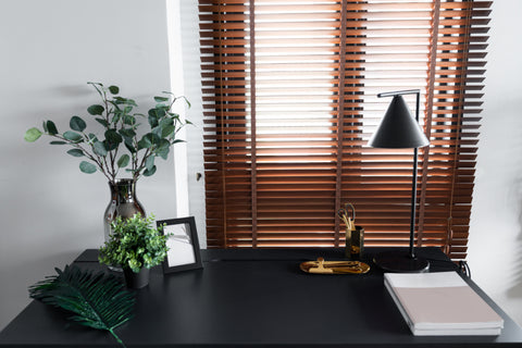 Wood Blinds brown color give shades in a living room