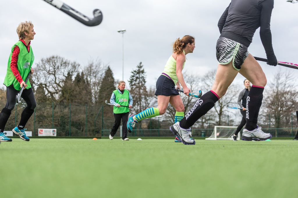 successful hockey players training on the field