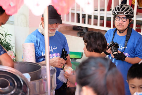 Khun Suchao scooping ice cream for the kids