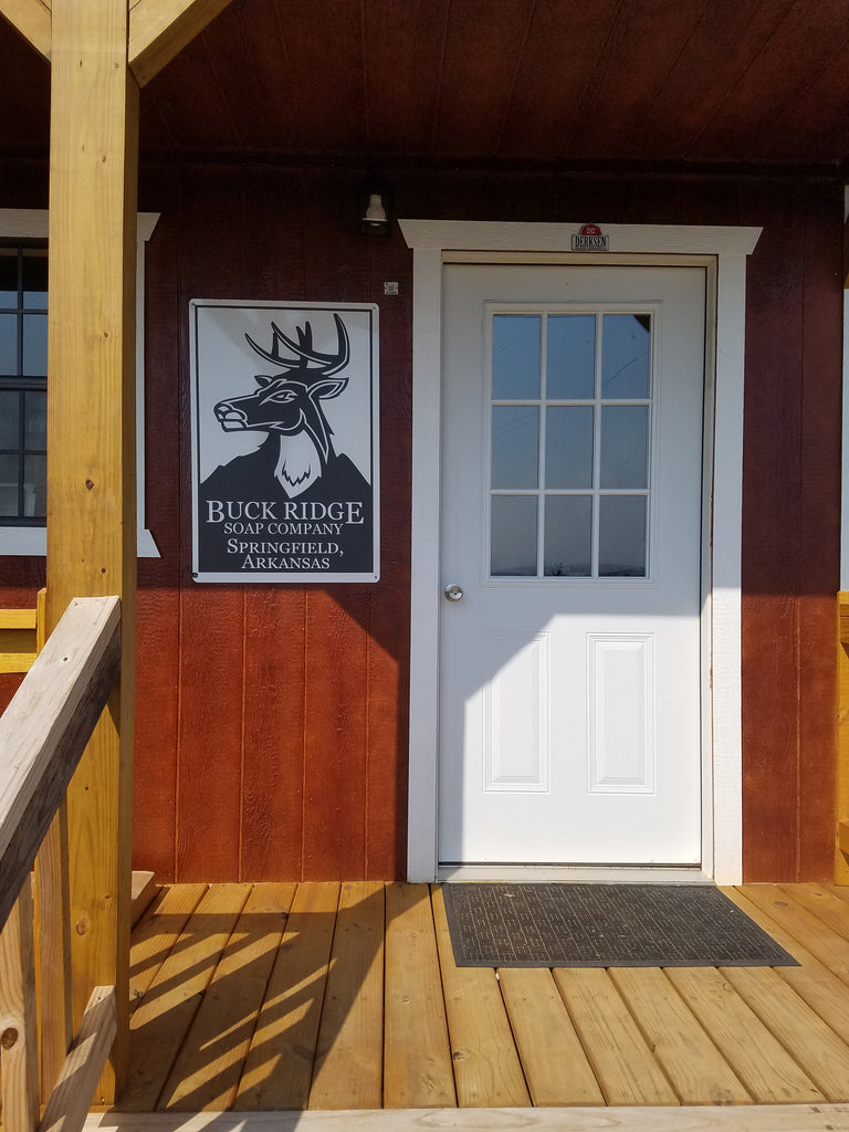 New sign and front door of Buck Ridge Soap Company Workshop.