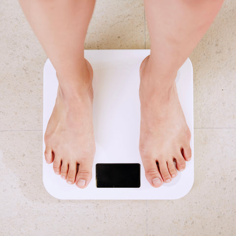 Woman standing on white digital scale