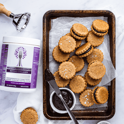 Edible Health bovine collagen powder and tray of homebaked biscuits