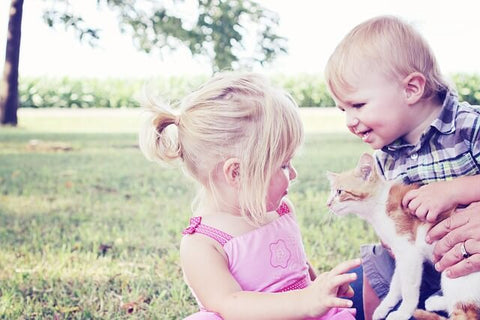 Girl And Boy With Pet Cat