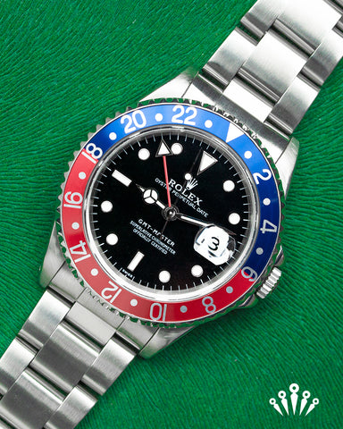 Rolex, GMT Master II, Stainless steel,  black dial, date, Red & Blue Bezel, Pride and Pinion