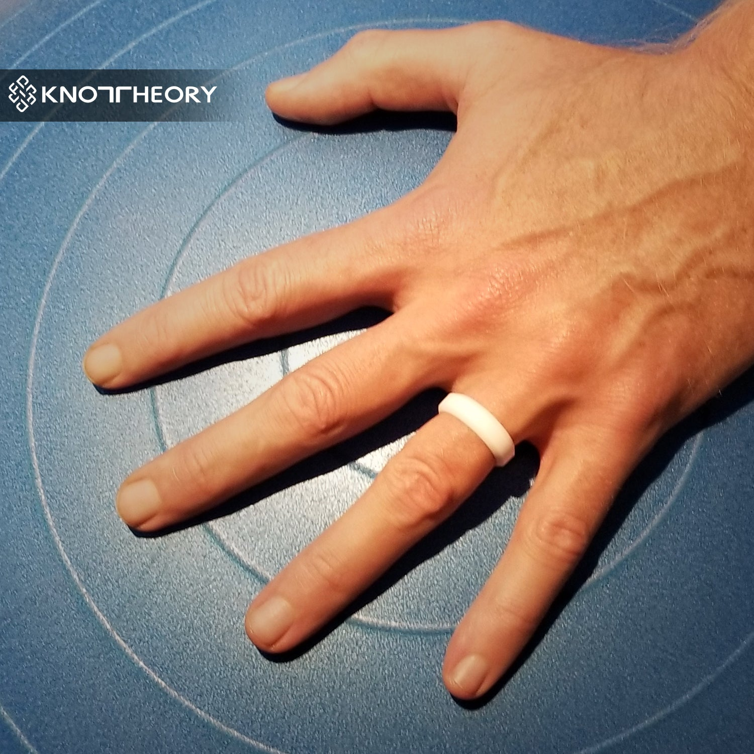 It is a picture of White Silicone Wedding Ring Man