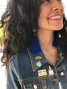 How to wear and style enamel pins