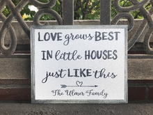 Love grows best in little houses like this. This is a farmhouse style CANVAS with a wood grain gray frame background printed on the canvas. White AND gray and can be personalized