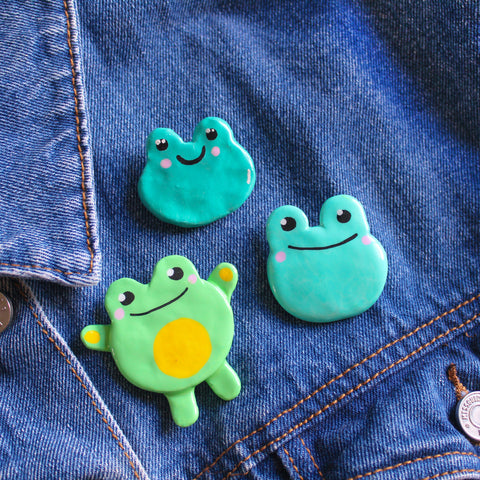 Cute Frog Clay Badges on a denim jacket