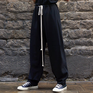 832e7f49ca3 YUIKI SHIMOJI UNISEX DRAWSTRING PLEATED TROUSERS BLACK-DOSHABURI Shop