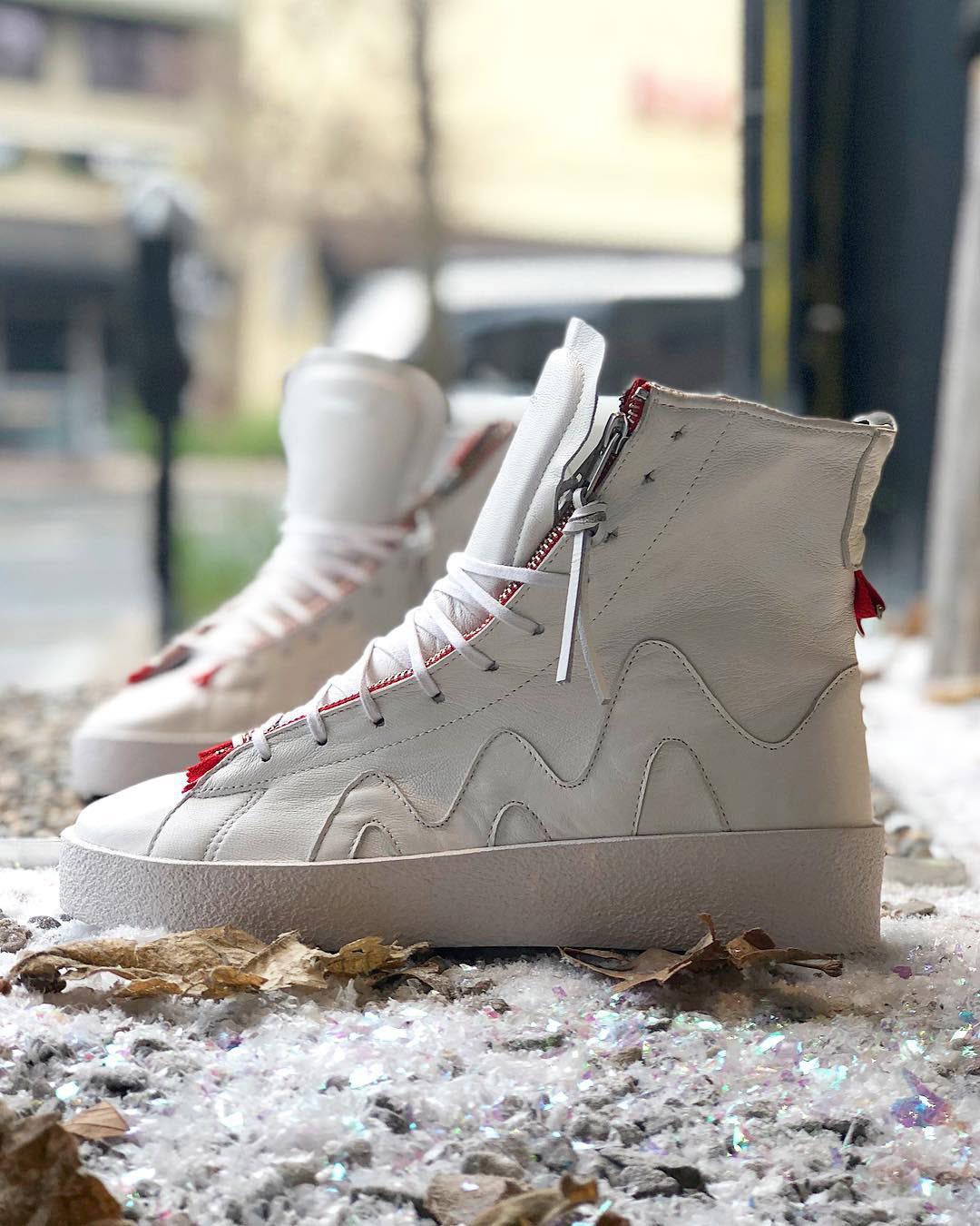 the clutch white widow by clearweather zipper stash pockets hi-top sneaker on thedrop