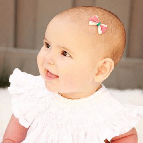 Girlie Glue is perfect for sticking bows to babies. It is made with Agave nectar and other all-natural ingredients. It is safe for skin and hair and washes away easily with water.