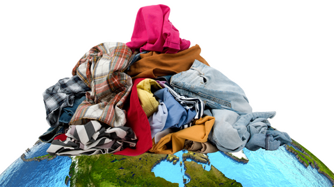 Pile of old clothes on the earth