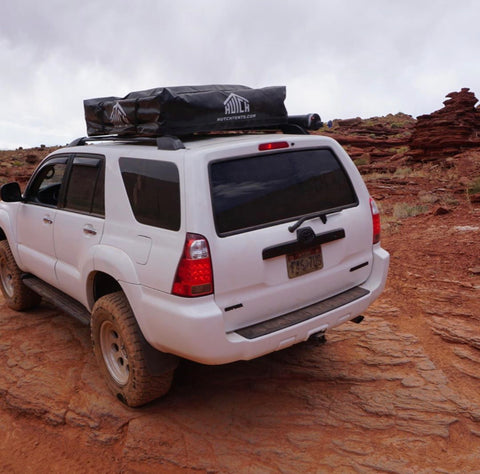 White Toyota 4Runner Driving | Hutch Tents