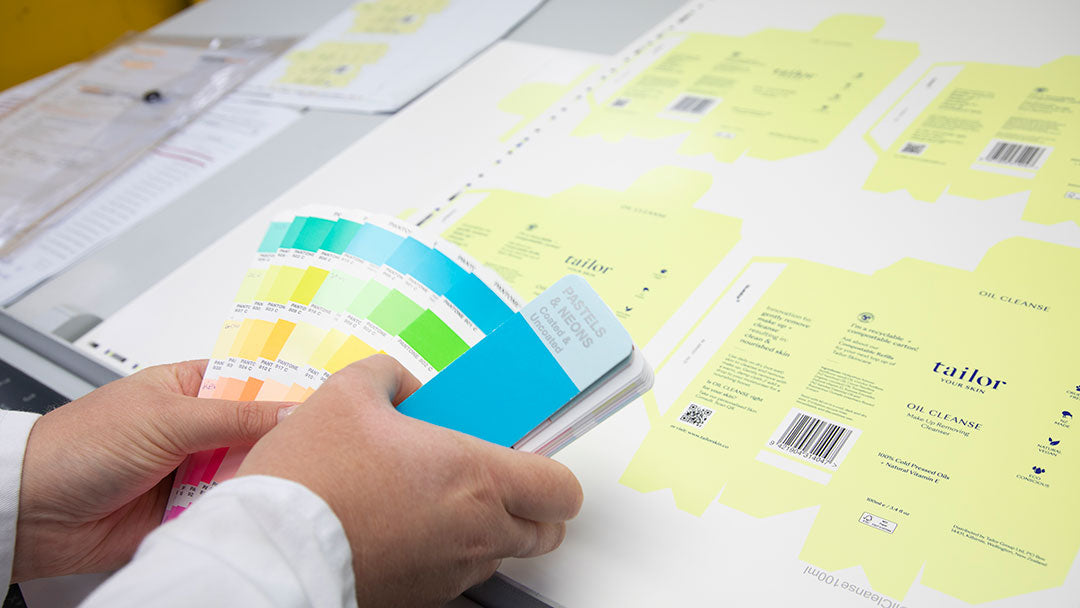Woman Matching Pantone Colour For Tailor Skincare's New FSC Certified Packaging