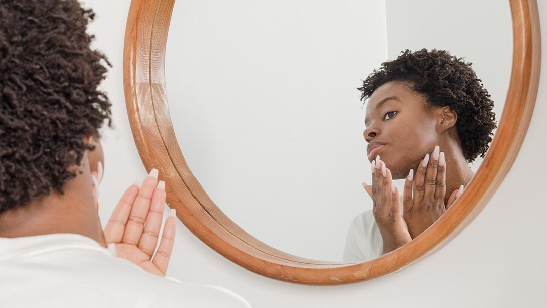 Woman Applying Silicone Free Natural Moisturiser to Face
