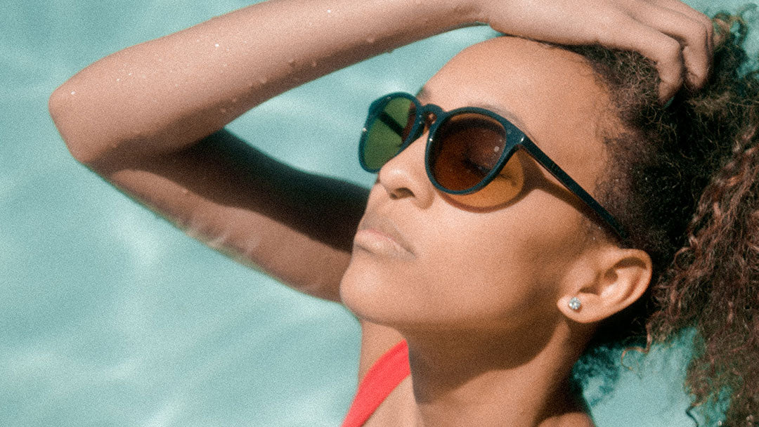 Woman wearing sunglasses in the pool