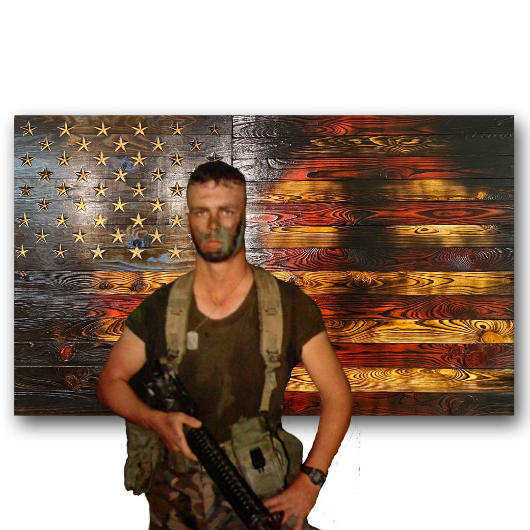 United States Marine standing in front of Battlefield Worn series wooden rustic flag made by Etherton Hardwoods in the USA.
